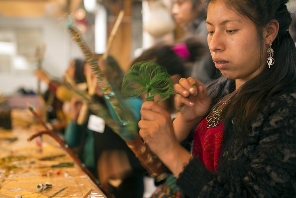 """Migrant girls and women participate in indigenous artistic courses in Colectivo Vida Digna's """"Ix Kame"""" School for Indigenous Women in Guatemala."""