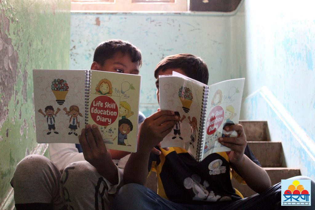 Children at Prerana use a bi-lingual journal to build stills in critical thinking, problem solving, and self-reflection. © Prerana
