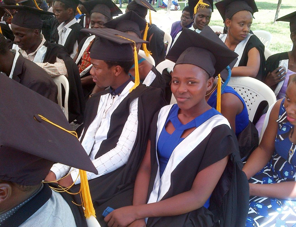 Rebecca, youth participant at CIYOTA in Uganda, waits to receive her high school diploma