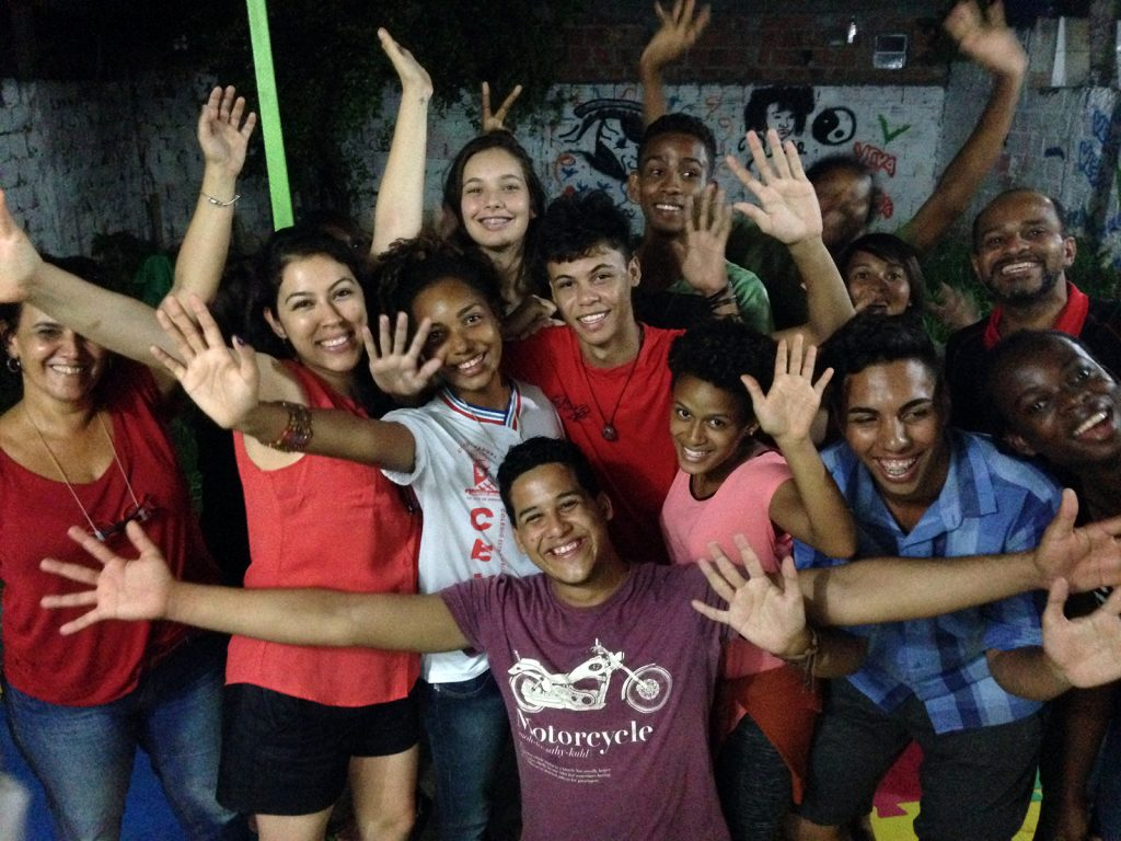 Youth raise their hands at Viva a Vida in Brazil