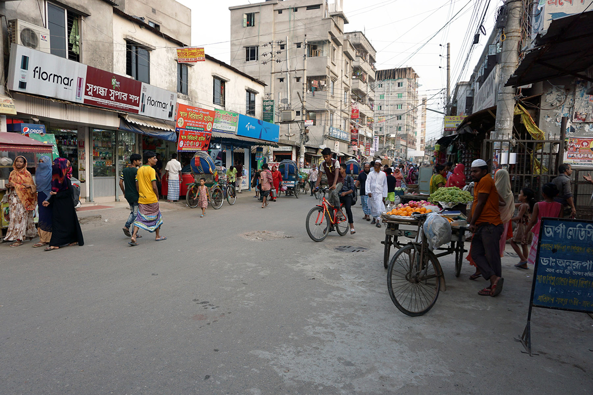 Busy street scene in Dhaka outside APON