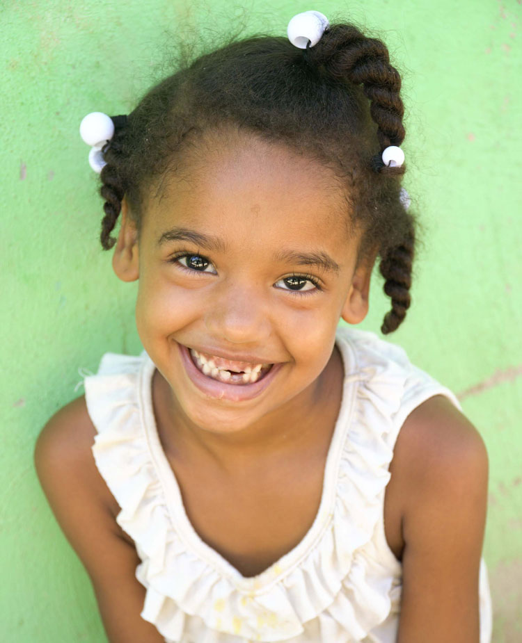 A girl smiles at the camera. © Fundación La Merced / Dominican Republic