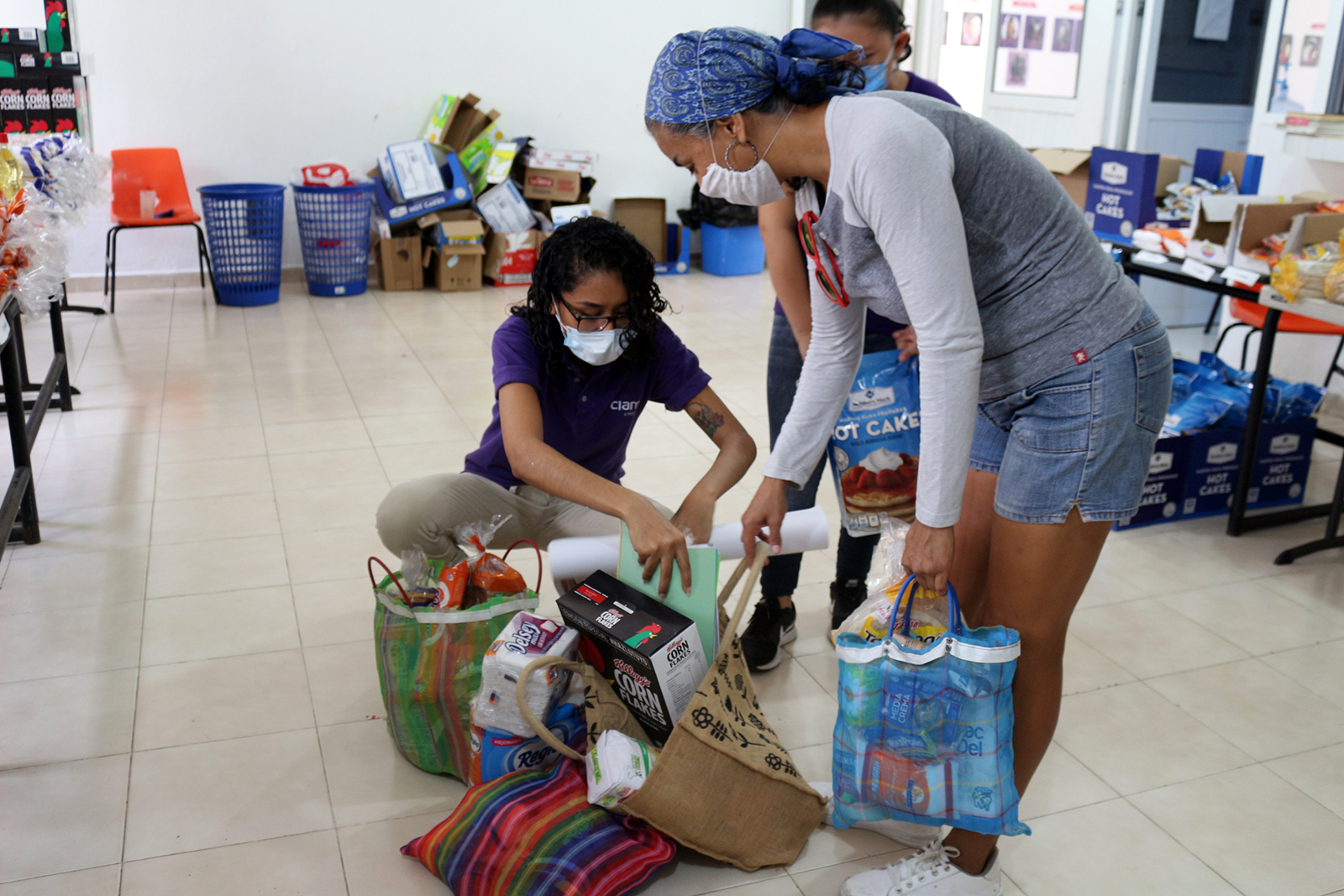 CIAM team members pack up food and sanitation supplies for children and families in marginalized neighborhoods of Cancun, Mexico.