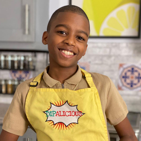 Omari McQueen standing in his kitchen.