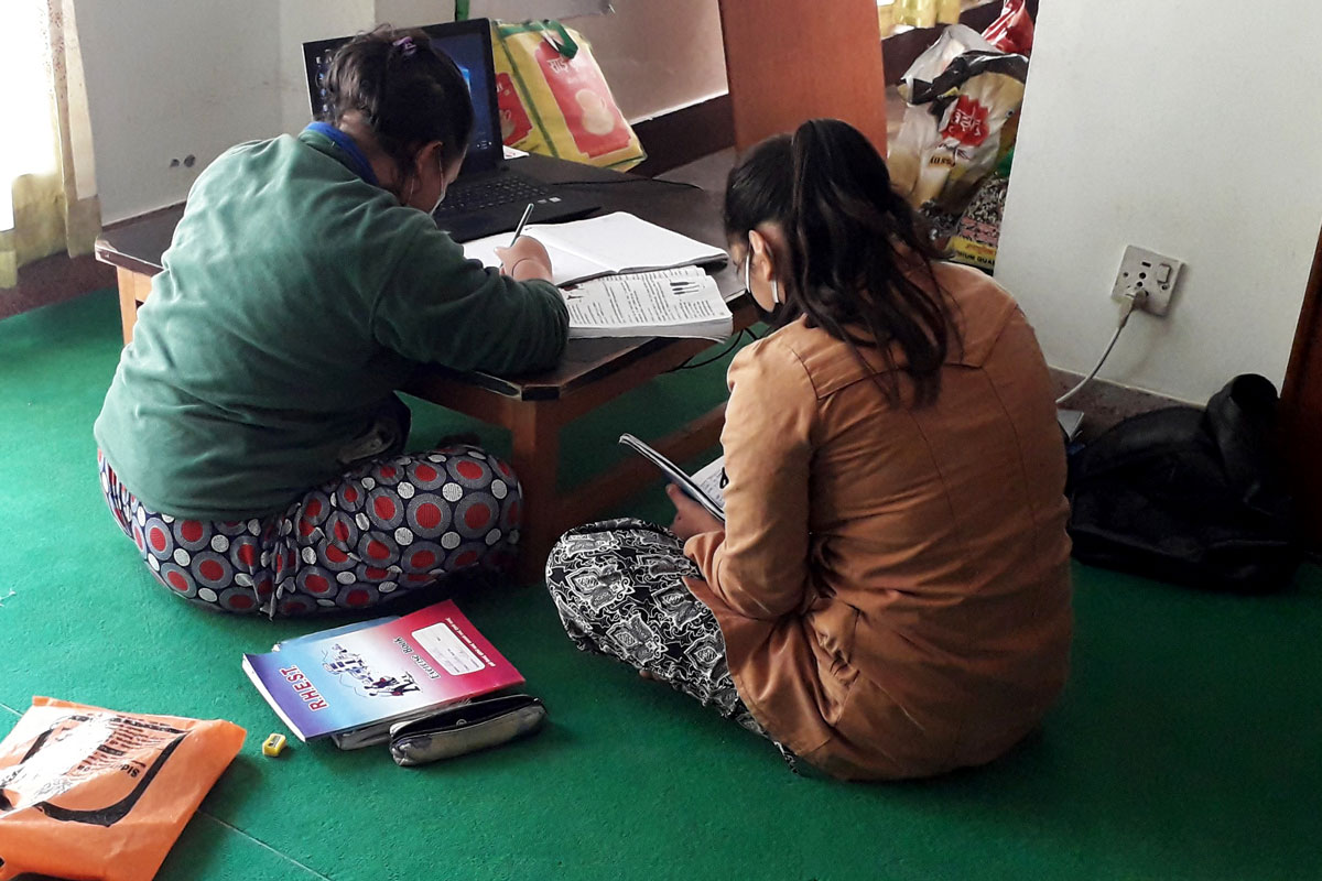 Children studying online at Asha Nepal's office.