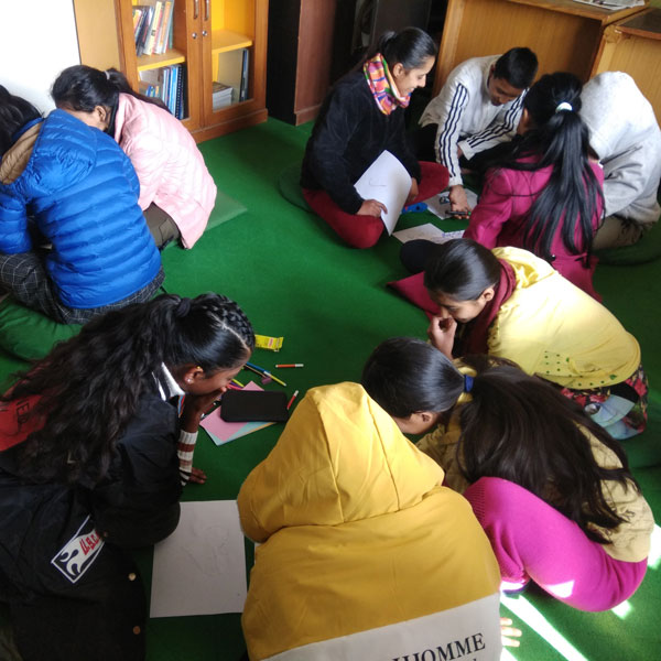 Participants seated on the floor during an Asha Nepal program.