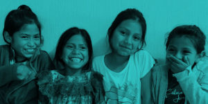 Girls in Guatemala smiling and laughing.