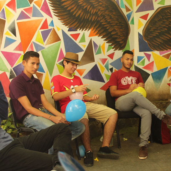 Young men participate in a reflection space in a healthy masculinities circle.