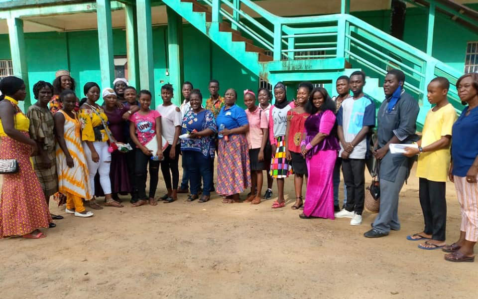 Amé Atsu David, GFC's Regional Capacity Development Specialist for West Africa, poses for a photo with Rassie Bah and representatives from other partner organizations in Sierra Leone and Liberia
