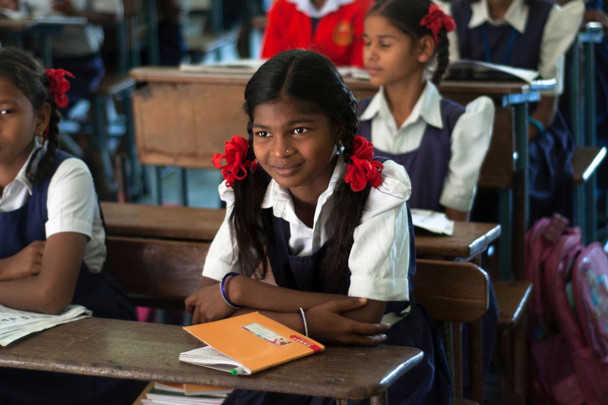 A girl in a classroom studying through LeapForWord