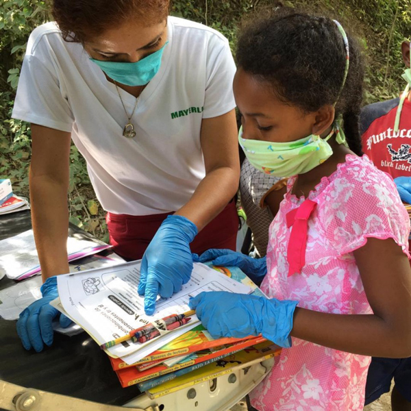 CREA members distribute reading materials for children, adolescents, and families.