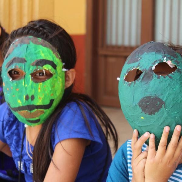 Two girls wearing masks