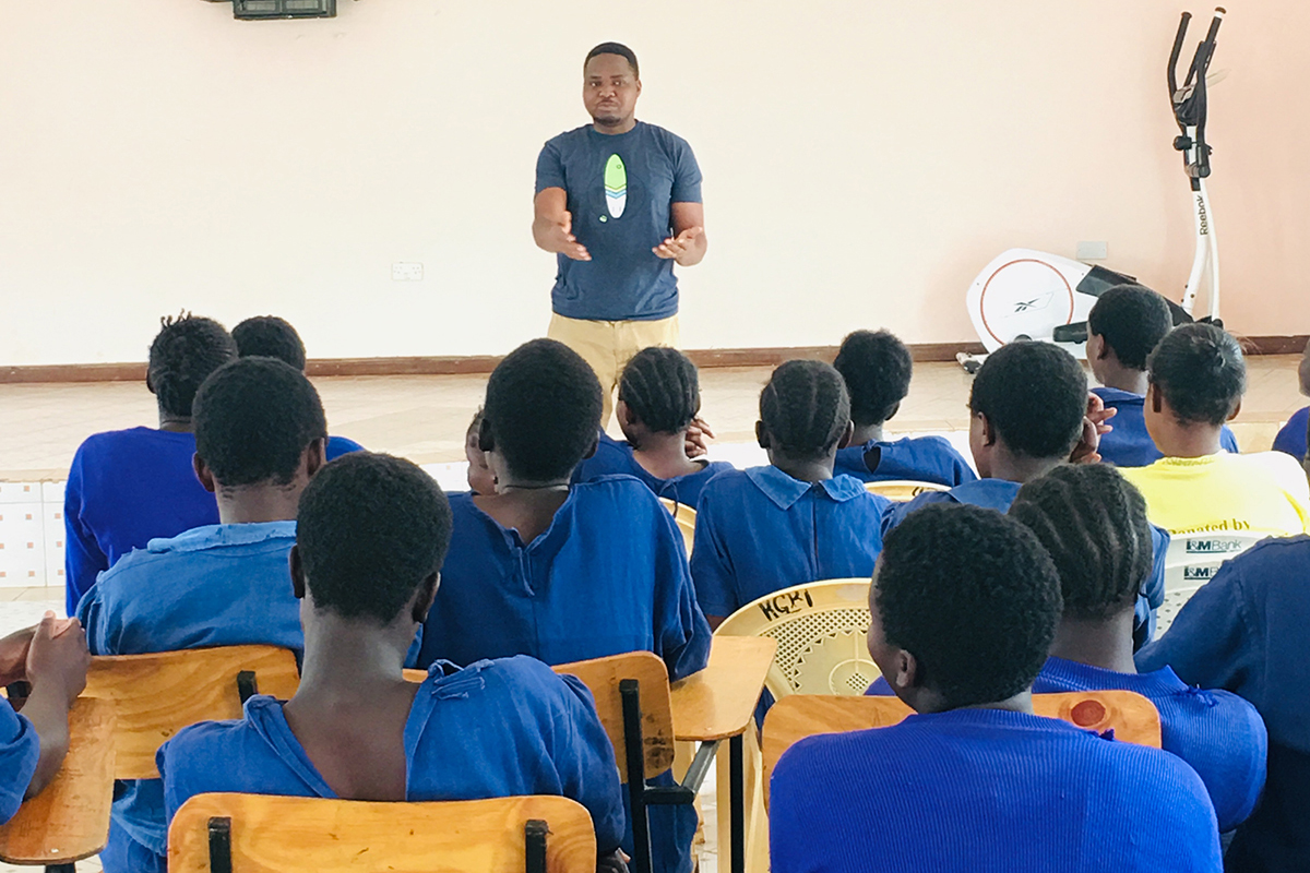 GFC Program Officer Bundie Kabanze speaks with girls at the Kamae Girls Borstal Institution on a site visit to Youth Safety Awareness Initiative in Kenya.